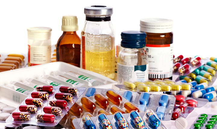 A variety of medicine in bottles and pill form