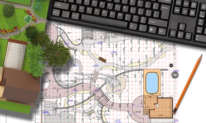 Plan of garden land, keyboard and pencil on a table