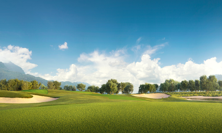 Bright green golf course in front of blue sky and a tree line