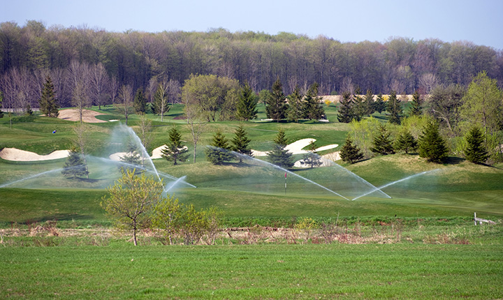 Sprinklers on a scenic golf course
