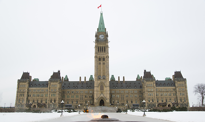 Canadian parliament building with cauldron burning