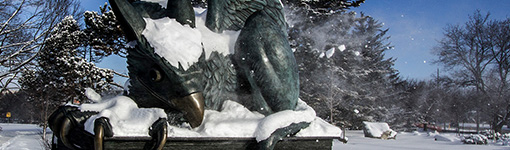snow covered gryphon statue