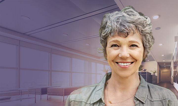 Head shot of middle aged woman overlayed on background image of office space